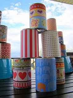 Diy circus party game - cover leftover cans with paper, stack them to knock down!