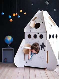 "How to Build a Cardboard Rocket Ship: My son asked Santa for a ""real rocket ship"" this Christmas to take the family to the moon. Santa has trouble getting rocket fuel this time of year so this is how I built a cardboard rocket. Cardboard Rocket, Cardboard Crafts, Cardboard Playhouse, Cardboard Spaceship, Cardboard Furniture, Bed Furniture, Fireplace Furniture, Furniture Ideas, Furniture Design"