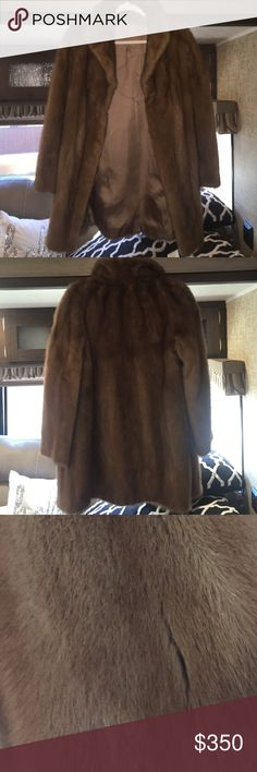 Mink Fur Coat Brand new in perfect condition Authetic Mink fur, unisex coat lined inside, I would size it as a medium but any size could wear it. There's belt loops inside so you could add one to tie it closed hits around the knees perfect gift for the holidays feel free to make reasonable offer Jackets & Coats