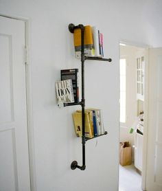 Definitely doing this. Industrial Metal Pipe Bookshelf is a great piece, this pipe shelf balances books using the pipe and the wall creating a beautiful bookshelf. It has a glass antique style knob on the middle shelf. Can easily make the shelves go anyway you want them to..