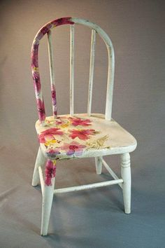 Annie Sloan's chalk paint was aged with clear and dark wax to give this antique child's chair a warm white finish. Decoupage flowers add a touch of whimsey and color. The dimensions of the chair are 10 by 22 inches. Hand Painted Chairs, Hand Painted Furniture, Paint Furniture, Repurposed Furniture, Furniture Projects, Furniture Makeover, Cool Furniture, Antique Furniture, Wooden Chair Makeover