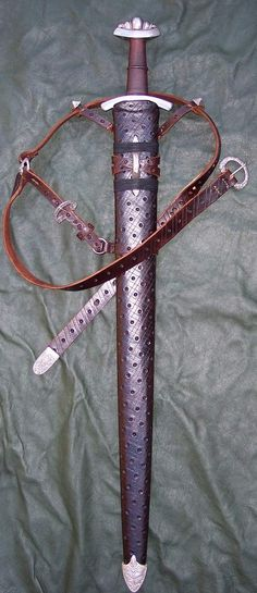 A complicated Viking Style suspension system is the highlight of this Jarl scabbard.
