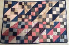 This auction is for a small crib or lap quilt. The quilt top fabric dates to the late 1800's. The quilt measures 39 inches x 26 inches.