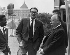 """Photograph of Gregory Peck visiting Alfred Hitchcock, taken during the filming of """"The Birds""""."""