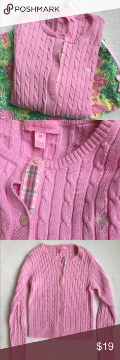 Lilly Pulitzer girl's sweater. Size 10 🎀 Lilly Pulitzer hot pink cable knit cardigan sweater.  Has navy palm tree logo and very cute grosgrain plaid ribbon down the side where buttons are.  Excellent condition. Great light sweater that works from spring to summer.  Looks so cute with Lilly dresses on chilly nights. ☺️100% cotton. Smoke free/pet free home. Lilly Pulitzer Shirts & Tops Sweaters