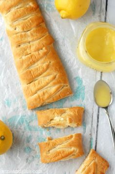 This Lemon Cheesecake Crescent Braid from Wine & Glue is a easy three ingredient recipe that is perfect from a summer brunch. Lemon curd and cream cheese are combined inside crescent rolls and baked for a tart, flaky treat.