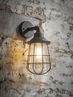 Cage outdoor wall in grey finish. Illuminate your outdoor space with the Garden Trading Finsbury Wall Light.Inspired by industrial Victorian lights, this outdoor lighting addition can be used indoors or out. Outdoor Wall Lighting, Outdoor Walls, Modern Lighting, Outdoor Porch Lights, Garden Lighting Ideas Uk, Outside Lights On House, Modern Exterior Lighting, Indoor Outdoor, Contemporary Wall Lights