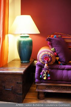 Delightful purples and colorful stripes.  That is an epic bolster pillow.  Love the pompoms and tassel.