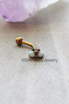 We're absolutely in love with this rose gold rook piercing barbell! Internally threaded and crafted from 100% hypoallergic titanium, this curved barbell features a stunning, creamy white opal trio on the front. Perfect for rook, vertical labret, daith, eyebrow, snug and anti eyebrow piercings. $39.99+S&H SirenBodyJewelry.etsy.com
