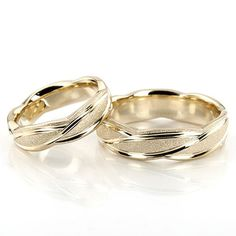 25karats.com A sleek contemporary design, this 6mm wide Fancy Designer wedding ring set has curved uneven cuts, creating a beautiful style. This band is also available in 5, 7, 8, 9, 10mm. The band is stone finished, with bright cuts.