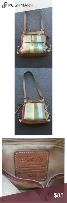 *SALE 24HR*Rainbow Leather Purse Beautiful Fossil bag with multi-colored leather.  Front pocket with magnetic closure, main compartment with an inner zippered pocket and two pouches, and a zippered compartment in the back with credit card holders and another inner zippered pocket.  Some natural wear and fading of the leather, but it gives it more character in my opinion.   Lots of room for all your things, but still a low profile purse. Really adore it and I'm pretty attached to it, but I…