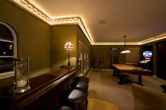 Lighted crown molding. Great way to light up a hall or kitchen area for night-time travelling to the bathroom or for a midnight snack.