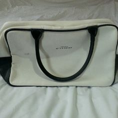 Givenchy bag Givenchy bag that can be used for travel and such. Has a few stains but that can be easily washed. Also has a very cute striped interior! Givenchy Bags Shoulder Bags