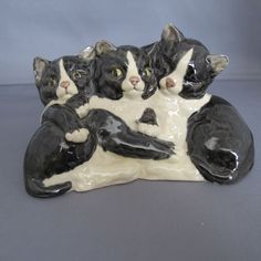"Three Black & White Cats Porcelain Figurine 5 1/2 x 3 1/2""   Adorable preowned figurine of three black & white cats nestled together. 5 1/2 x 3 1/2 inches. The figurine is signed but can't read the signature."