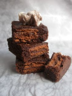 Lick The Spoon: Tim Tam Brownies    My hubby would love these! He introduced me to Tim Tams!