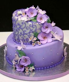 Beautiful and delicate lavender and silver butterflies with frangipanis with a twist of whimsy with the topsy turvy cake design. Beautiful Wedding Cakes, Gorgeous Cakes, Pretty Cakes, Cute Cakes, Amazing Cakes, Purple Cakes, Adult Birthday Cakes, Cake Birthday, Occasion Cakes