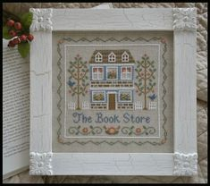 Country Cottage Needleworks Bookstore, The - Cross Stitch Pattern. Model stitched on 28 count Country French Cafe Mocha linen by Wichelt using DMC floss. Cross Stitch Books, Cross Stitch Kits, Cross Stitch Charts, Cross Stitch Designs, Cross Stitch Patterns, Cross Stitch Embroidery, Embroidery Patterns, Hand Embroidery, Country Cottage Needleworks