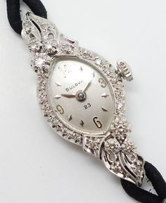 Rendered in fine 14k white gold, the ornate case and lugs are encrusted with 24 single cut diamonds. The diamonds are of VS clarity and GH color. The 23 jewel movement is adjusted five positions. In overall very good cosmetic condition with minor surface scratches and abrasions to the case, crystal, and dial. | eBay!