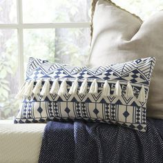 Every pillow is a little better with a tassel.  Matea Embroidered Pillow Cover #entertainwithbirchlane