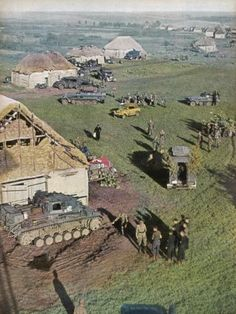 Operation Barbarossa, Tanks and other vehicles have arrived in a small rural village on the Eastern front. A Nazi flag has been placed near the house to protect against friendly fire. (Photo by Galerie Bilderwelt/Getty Images) Ww2 Pictures, Ww2 Photos, German Soldiers Ww2, German Army, Luftwaffe, Drow Male, Man Of War, Ww2 Tanks, Vietnam Veterans