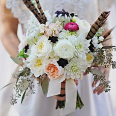White Bridal Bouquet with Pheasant Feathers // Amy Carroll Photography //  Bridal Bouquet: Posh Petals Flowers // http://www.theknot.com/weddings/album/a-rustic-glam-wedding-in-benton-harbor-mi-138521