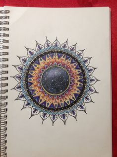 Another mandala using coloured pencils.