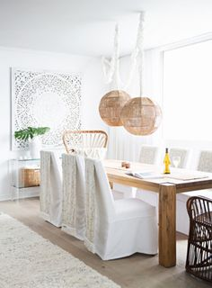 A neutral dining space with rustic charm. | http://domino.com