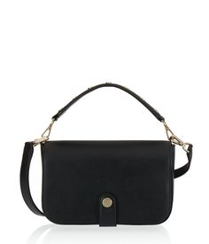 The Cooper Crossbody is easy, efficient, and oh-so edgy. Crafted with sensuous pebbled leather and satin lining, this diminutive designer handbag features a detachable card case, a studded and removable top handle, as well as a removable and adjustable crossbody strap—all for mod and maximum toting versatility.