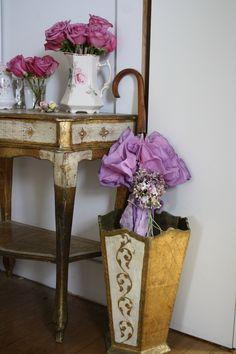 Florentine umbrella basket with a vintage ruffly umbrella.