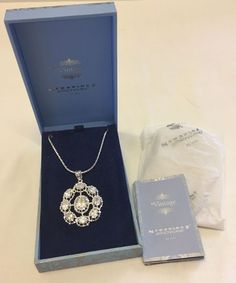 Lot 14 - Diamante set pendant on a chain by Newbridge Silverware - from their Vintage collection. In the
