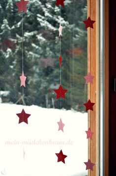 Erinnert ihr euch noch an die Sterne, die ich letztes Jahr aus alten Büch… Do you still remember the stars I punched out of old books and made into a star curtain last year? Christmas On A Budget, Winter Christmas, Christmas Time, Christmas Crafts, Christmas Window Decorations, School Decorations, Advent Candles, Creation Deco, Primitive Christmas