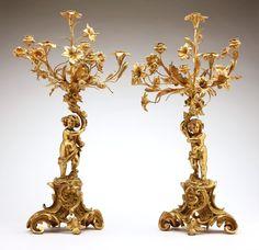 A pair of Louis XV style gilt-bronze six-light figural candelabra