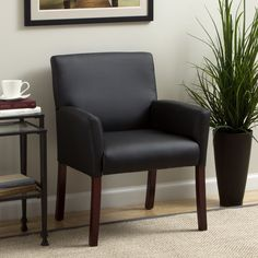 Soft and durable, this black guest arm chair from Boss Caressoft will provide long-lasting comfort in your home or office. Molded polyurethane armrests offer support, while rich mahogany wood finish legs give this chair a luxurious look.
