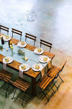 modern wedding reception - photo by Jackie Wonders http://ruffledblog.com/luce-loft-wedding-with-a-citrus-color-palette #weddingreception #tablescape