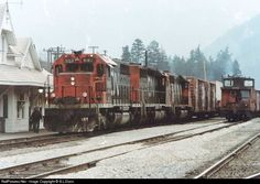 An east-bound speed train, likely 218, meets a west-bound drag of sulphur sitting on track one in Boston Bar, BC.  Photo Credit - S.L. Dixon via RailPictures.net