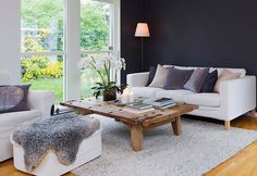 CÀLIDA PELL - we like the dark wall contrast with the fresh white furniture to compliment the dark color.