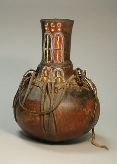 Africa | Vessel from the Turkana people of Kenya | Calabash, beads and leather | 20th century