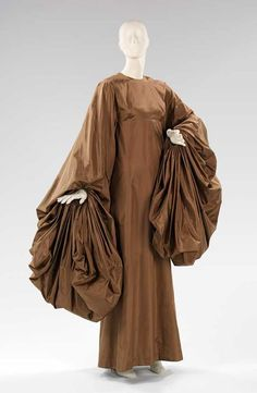 1969 fashion style couture gown wide billowing sleeves brown bronze dress gown 60s 70s.  Anyone know the designer of this?