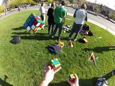 Amazing Guy Solves 3 Rubiks Cubes Whilst Juggling Them
