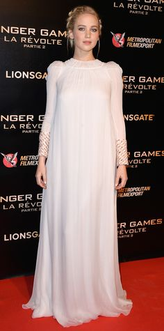 Jennifer Lawrence took a break from her streak of racy premiere looks and opted for a rather demure one for the Paris premiere of The Hunger Games: Mockingjay, Part 2, hitting the red carpet in an ethereal embroidered white silk chiffon Dior gown