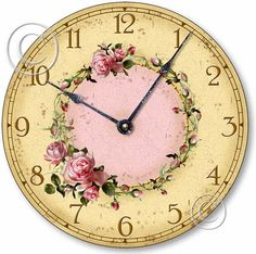 Shabby Chic Pink Roses Clock    ---    Beautiful pink cottage roses entwined in a circle form the center focal point on this shabby chic clock.  Crafted with vintage styling to appear aged.  Hands have a distressed finish.