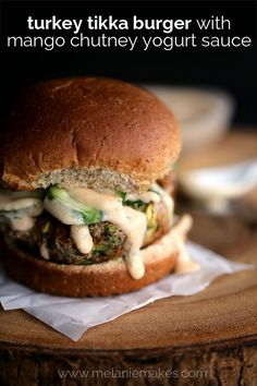 Ground turkey is studded with shredded zucchini and spiked with curry paste, cilantro, garlic and ginger to create one flavorful patty.  You won't believe how flavorful this Turkey Tikka Burger with Mango Chutney Yogurt Sauce is and those lucky enough to be served one would never guess how quickly they come together.