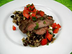 Grilled Flank Steak with Tomato Lime Salsa. #grilling #recipes From The Tasty Fork