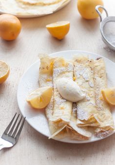 These crepes with whipped Meyer lemon ricotta are simple, classic, and uncomplicated. But instead of literally just making crepes–and adding powdered sugar and lemon juice– I decided to do a little bit of a spin on the whole lemon ricotta pancake concept. Köstliche Desserts, Delicious Desserts, Dessert Recipes, Yummy Food, Tasty, Plated Desserts, Brunch Recipes, Breakfast Recipes, Pancake Recipes