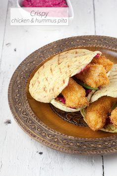 Crispy chicken and hummus pita made with red beets, so easy with only a few ingredients. Is there even anything better than fried chicken?
