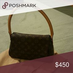 Louis Vuitton hand bag. Gently used,  no scratches Clutch bag, 100% authentic, in excellent condition.  Minimal darkening of handle which occurs naturally. 2 Chic Bags Clutches & Wristlets