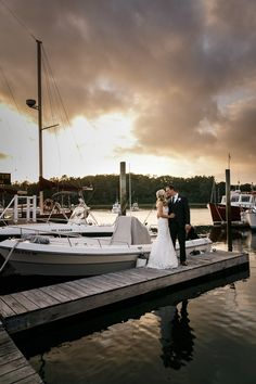 Dramatic skies and afternoon sun above this bride and groom on their wedding day at the Nonantum Resort in coastal Kennebunkport, Maine