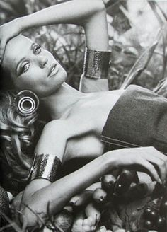 Veruschka in Brazil wearing gold arm cuffs. Photographed by Franco Rubartelli, 1968