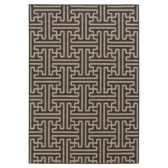 Anchor your living room seating group or patio ensemble with this artfully crafted rug, featuring a tessellated geometric pattern for eye-catching style.