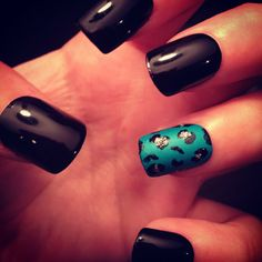 <3 black nails with teal/leopard accent nail